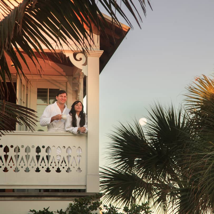 guests watch the sunrise on a balcony at Port D'hiver