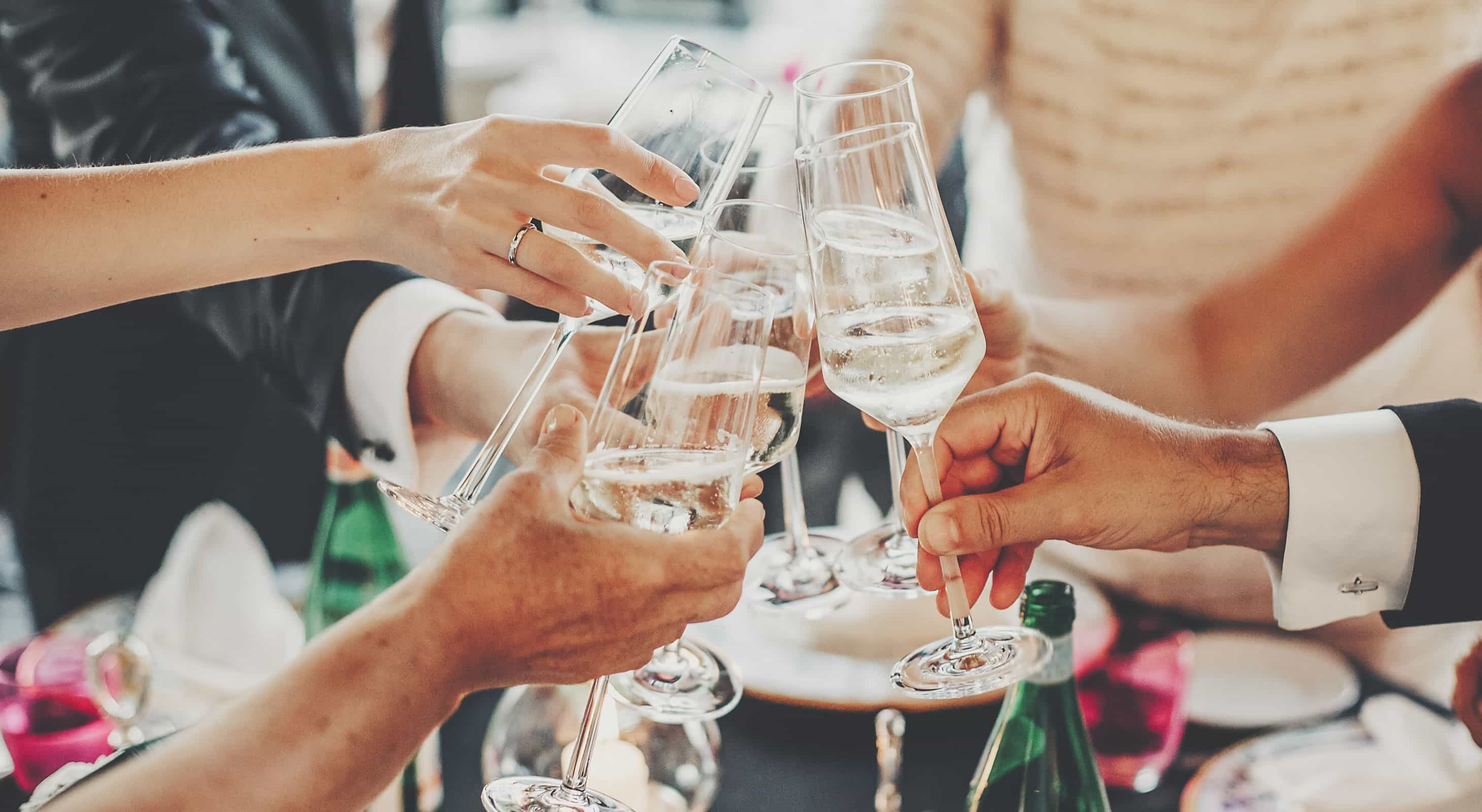 people toasting champagne flutes