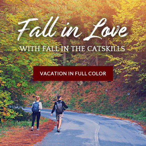 couple hiking among fall foliage