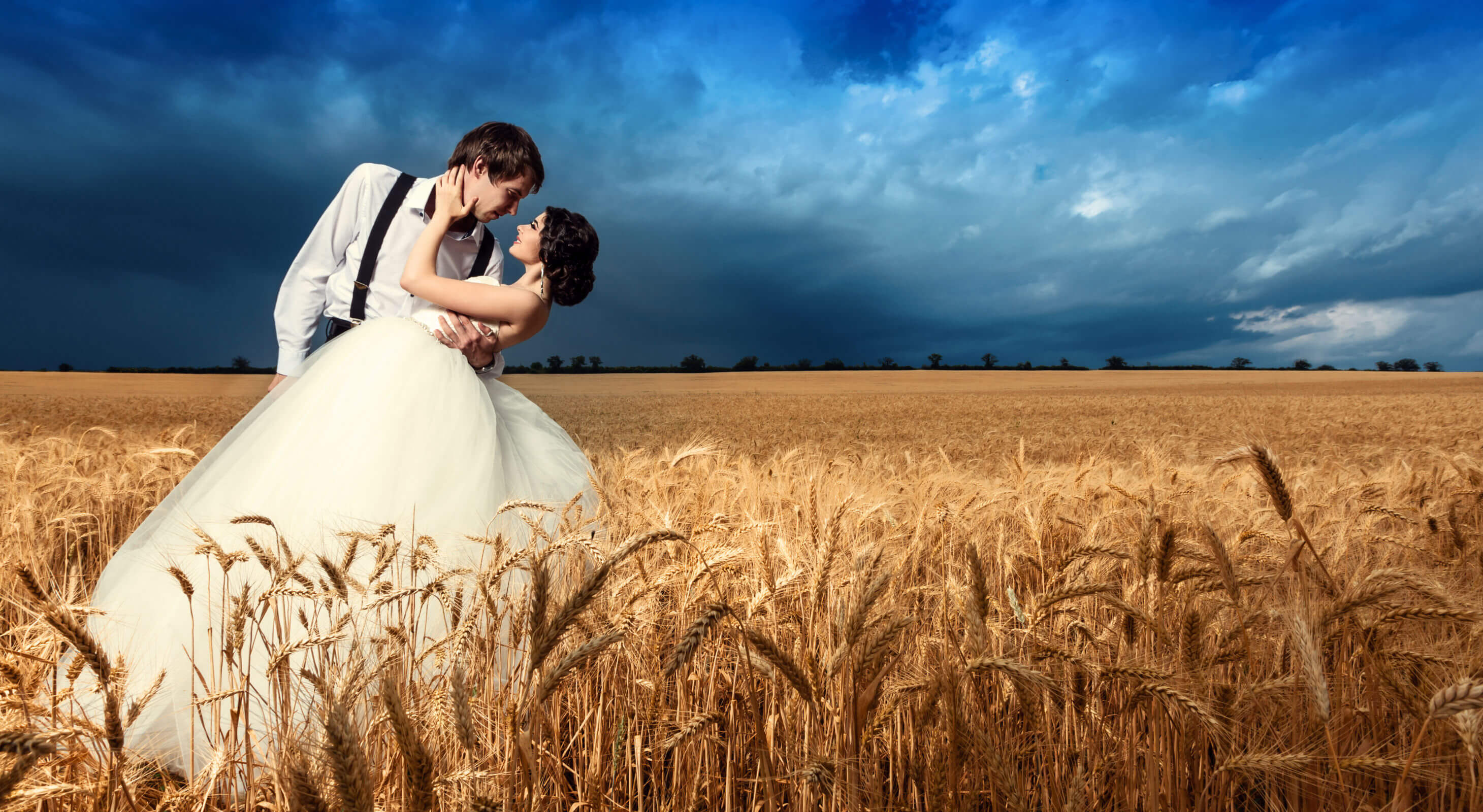 Wedding Venue in a wheat field - bride and groom