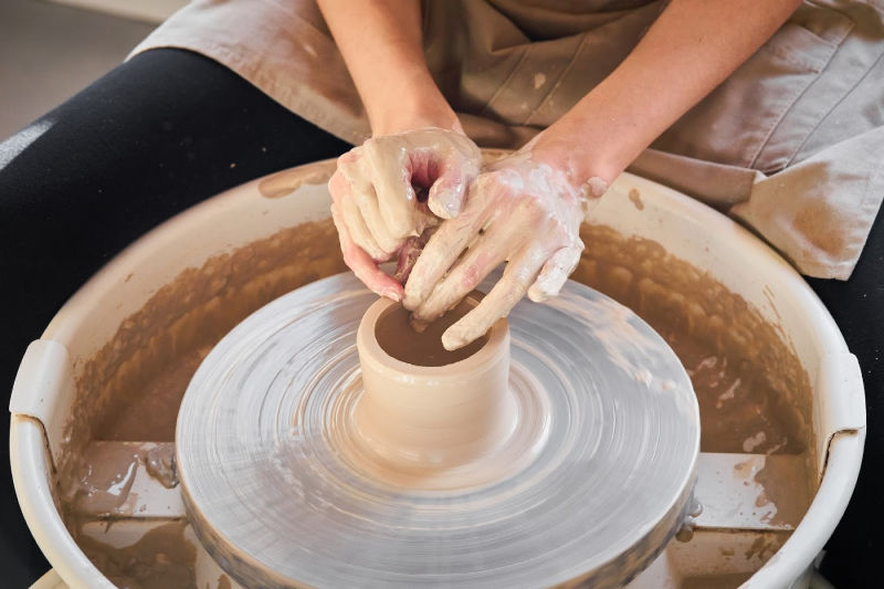 a woman at a pottery wheel