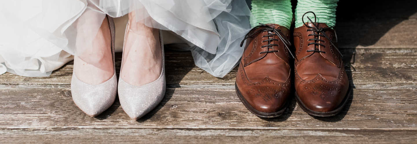 Bride and groom foot shot with wedding shoes