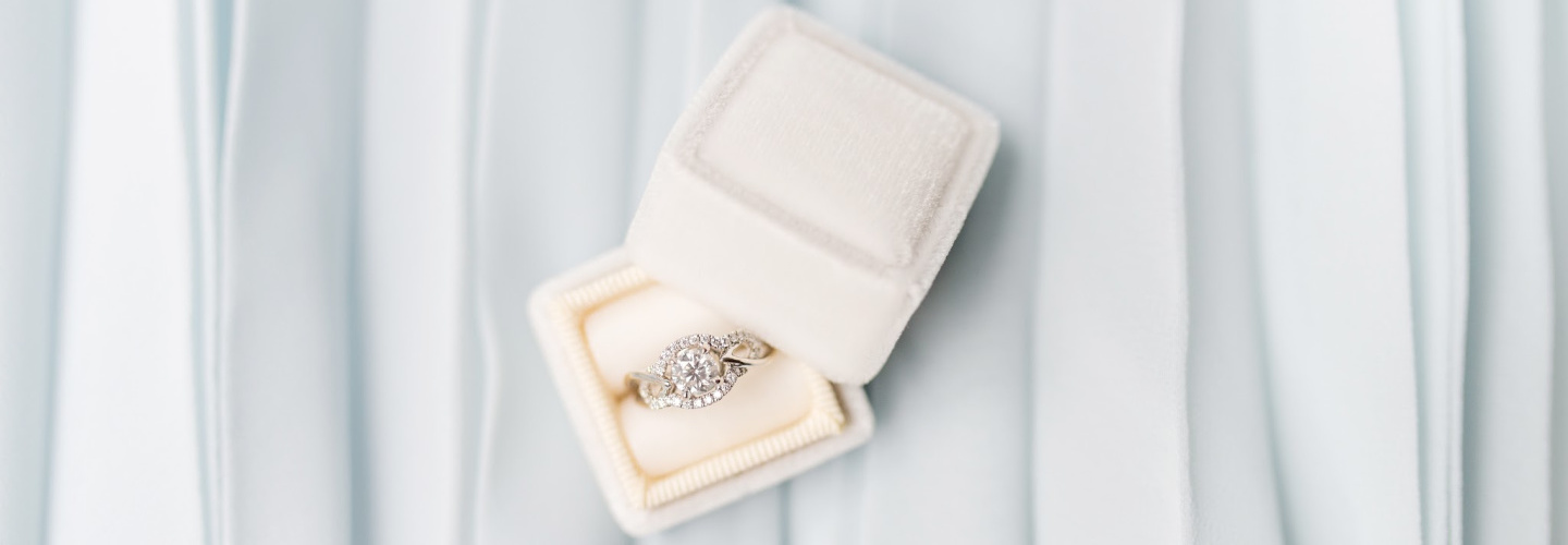 Boxed wedding ring on light blue table cloth