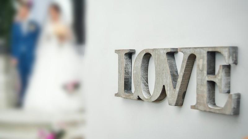 Up close shot of love wedding sign