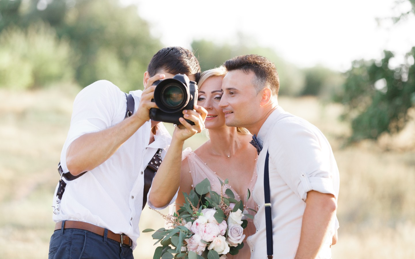 Wedding Marketing: Wedding photographer showing bride and groom photos