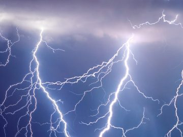 lightning strikes in a dark blue-gray strike