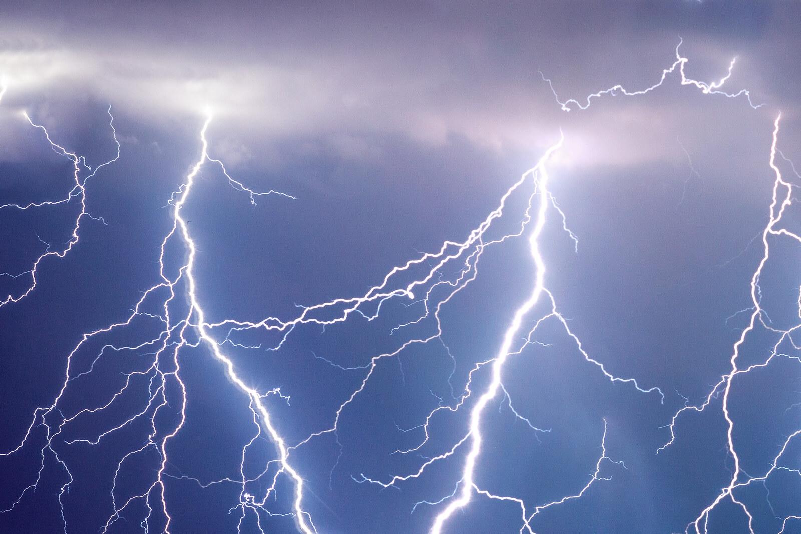 lightning strikes in a dark blue-gray strike