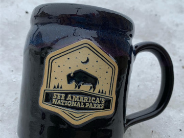 a mug with a national park logo