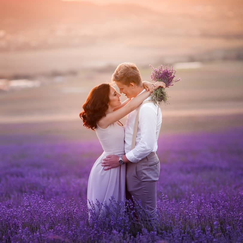 Couple standing in a field of lavender