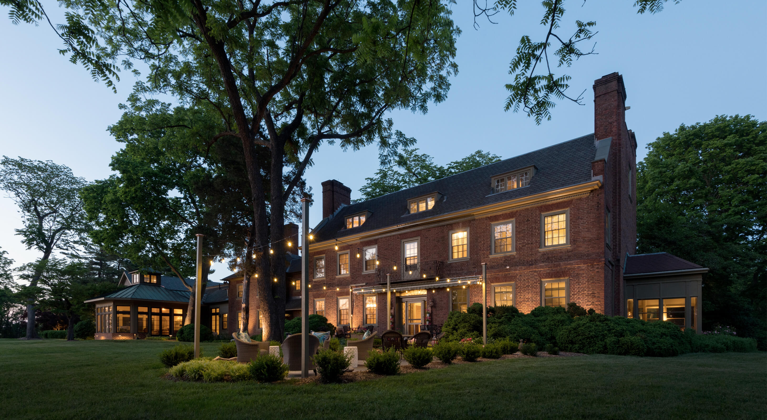 Great Oak Manor Exterior at Night