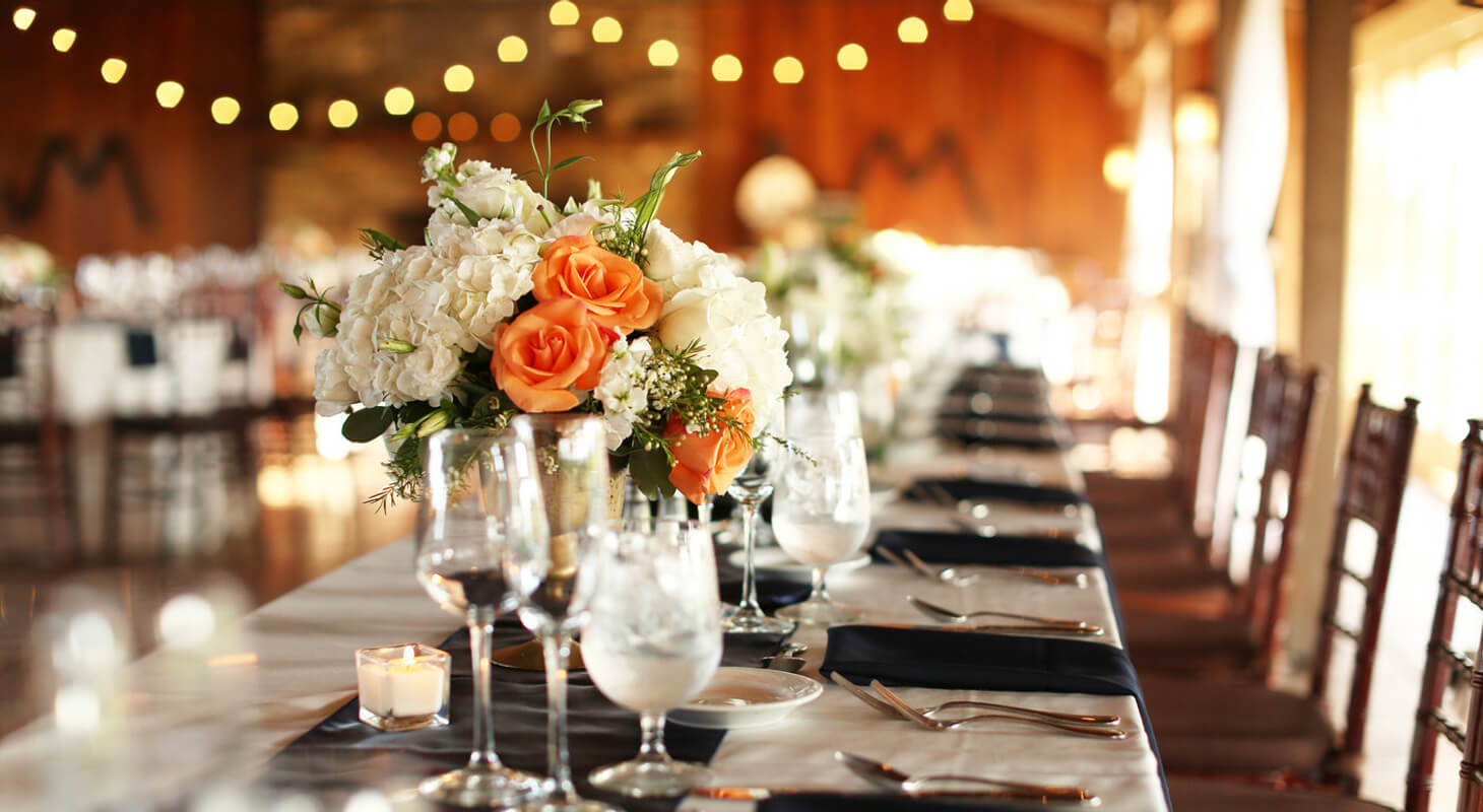 Table setting with orange roses - Wedding Website Design