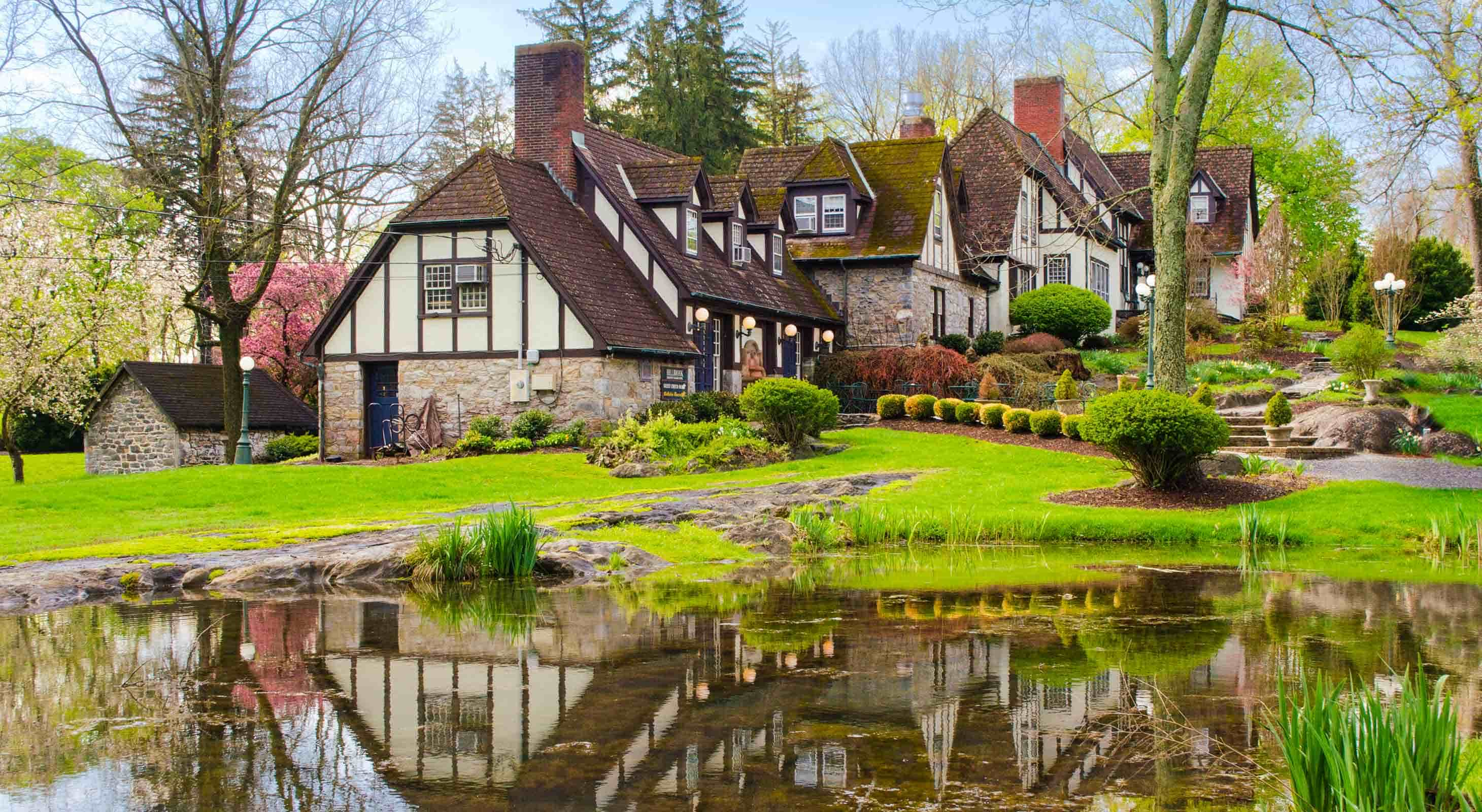 Exterior of Hillbrook Inn with a pond in the foreground - B&B Marketing Client