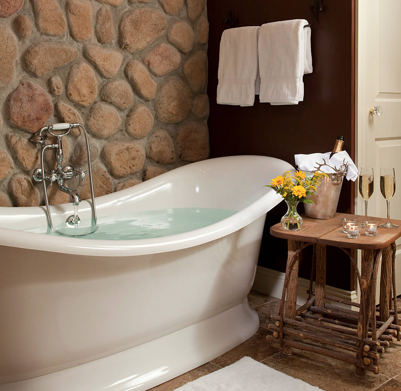 Stone wall with soaking tub and Champagne