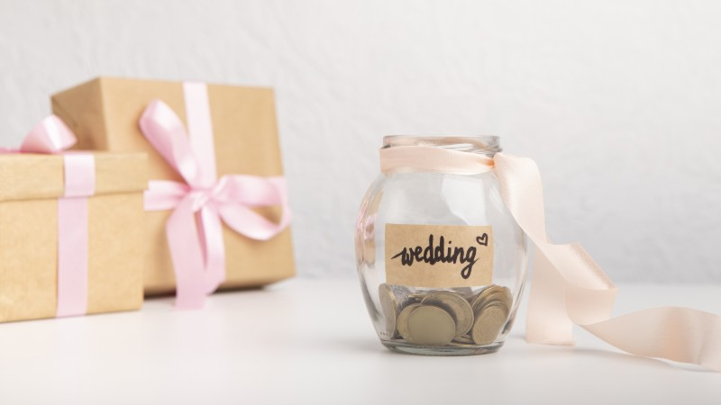 wedding venue revenue management glass jar coins