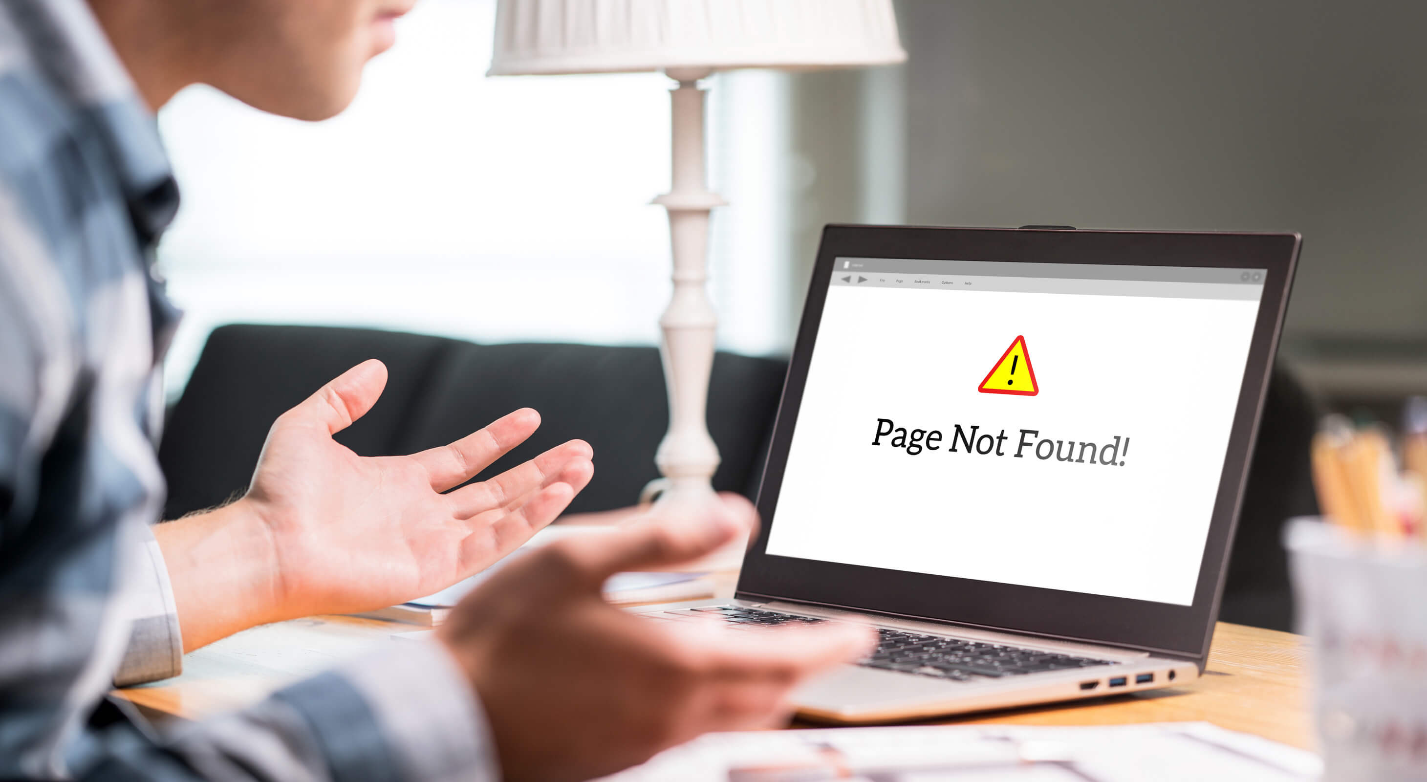 Frustrated person looking at screen displaying page not found