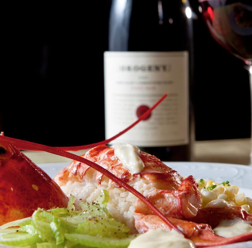 gourmet lobster dinner with wine