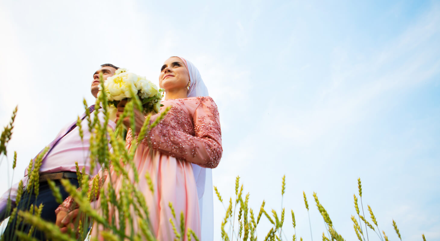 Muslim couple getting married in a field