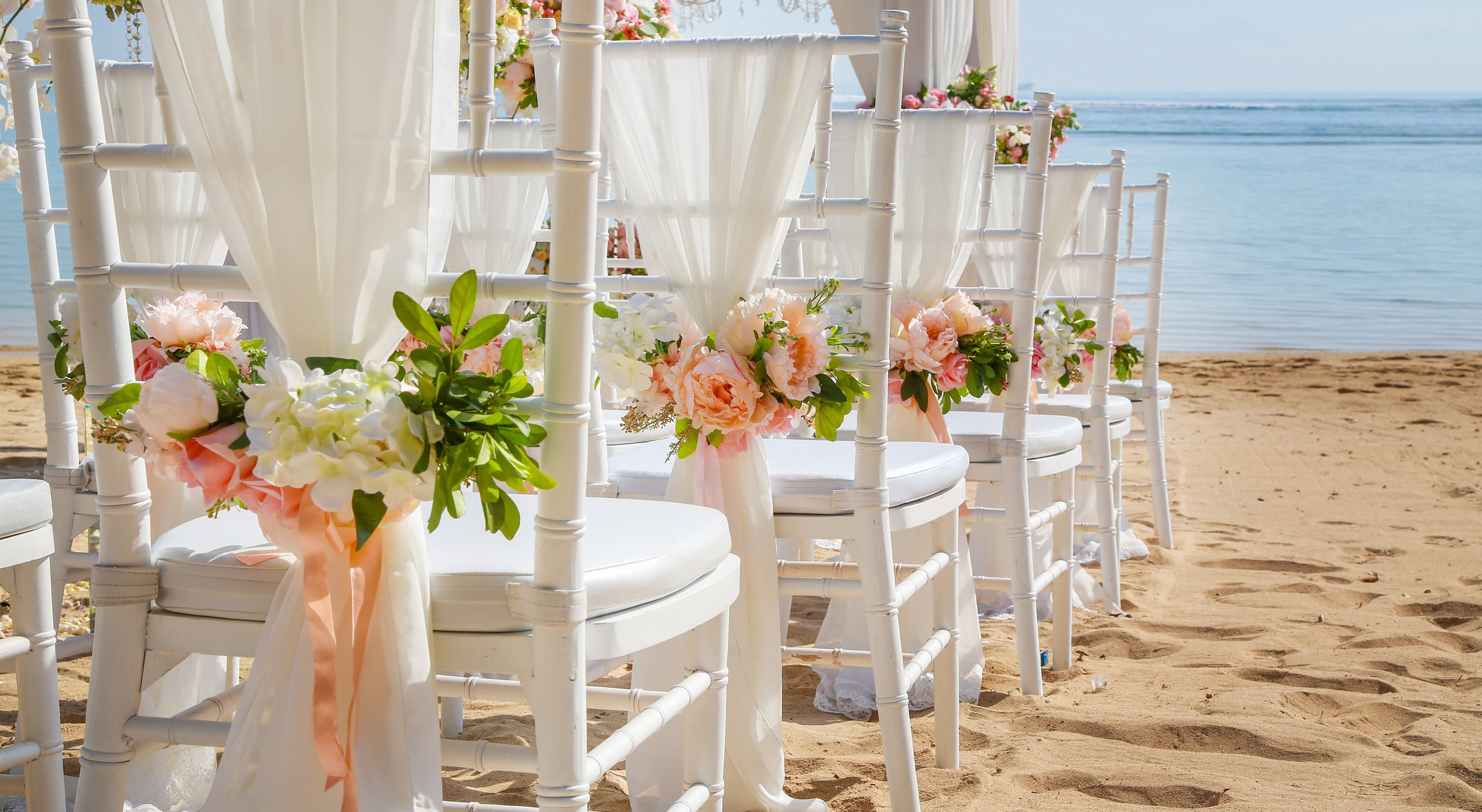 chairs set up for a wedding on the beach