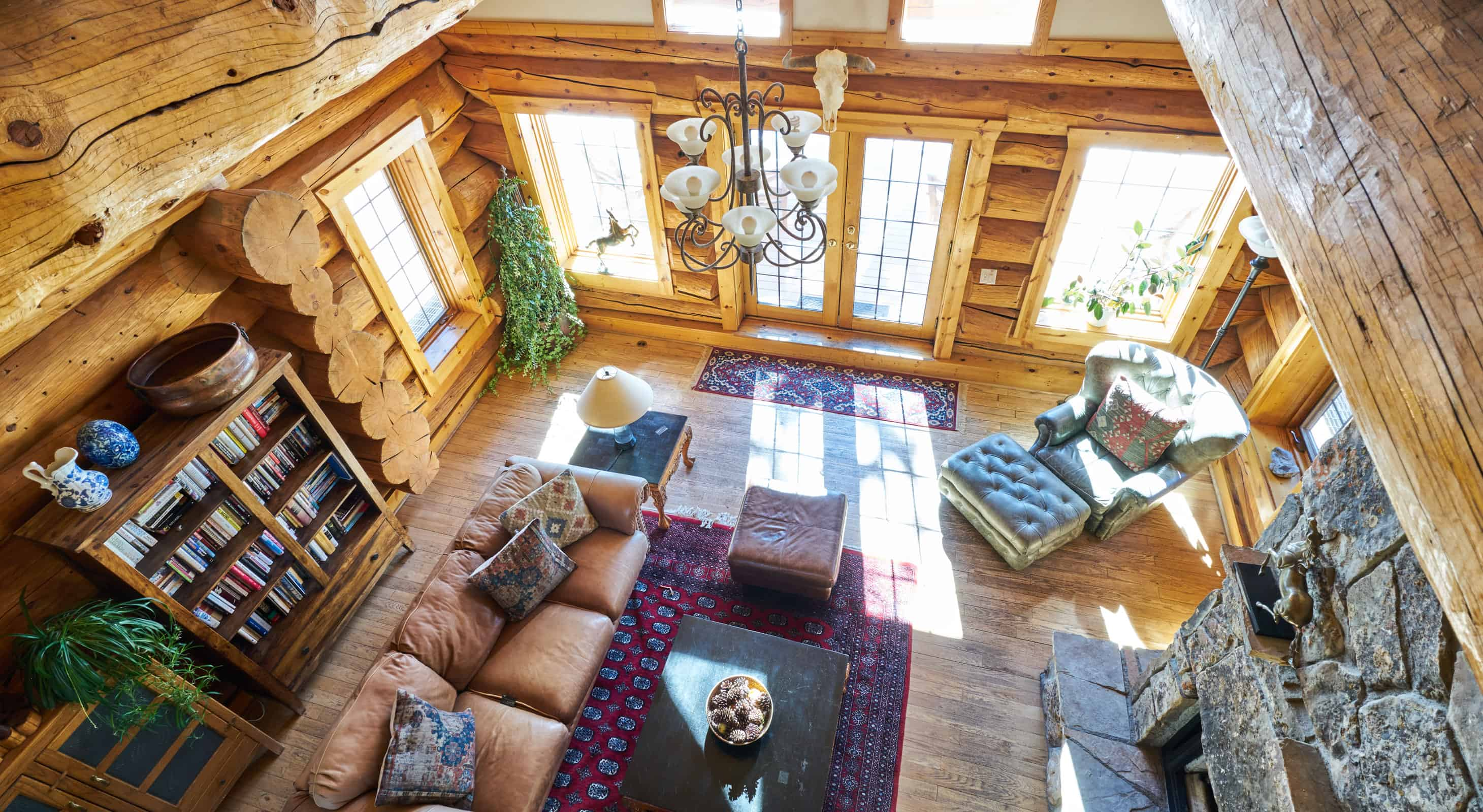 Log cabin lodge interior with rock fireplace - Rocky Mountains in Colorado