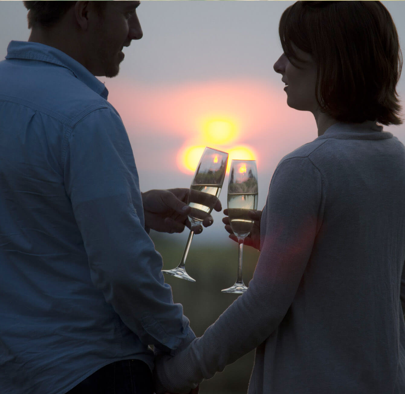 romantic sunset with couple and Champagne glasses