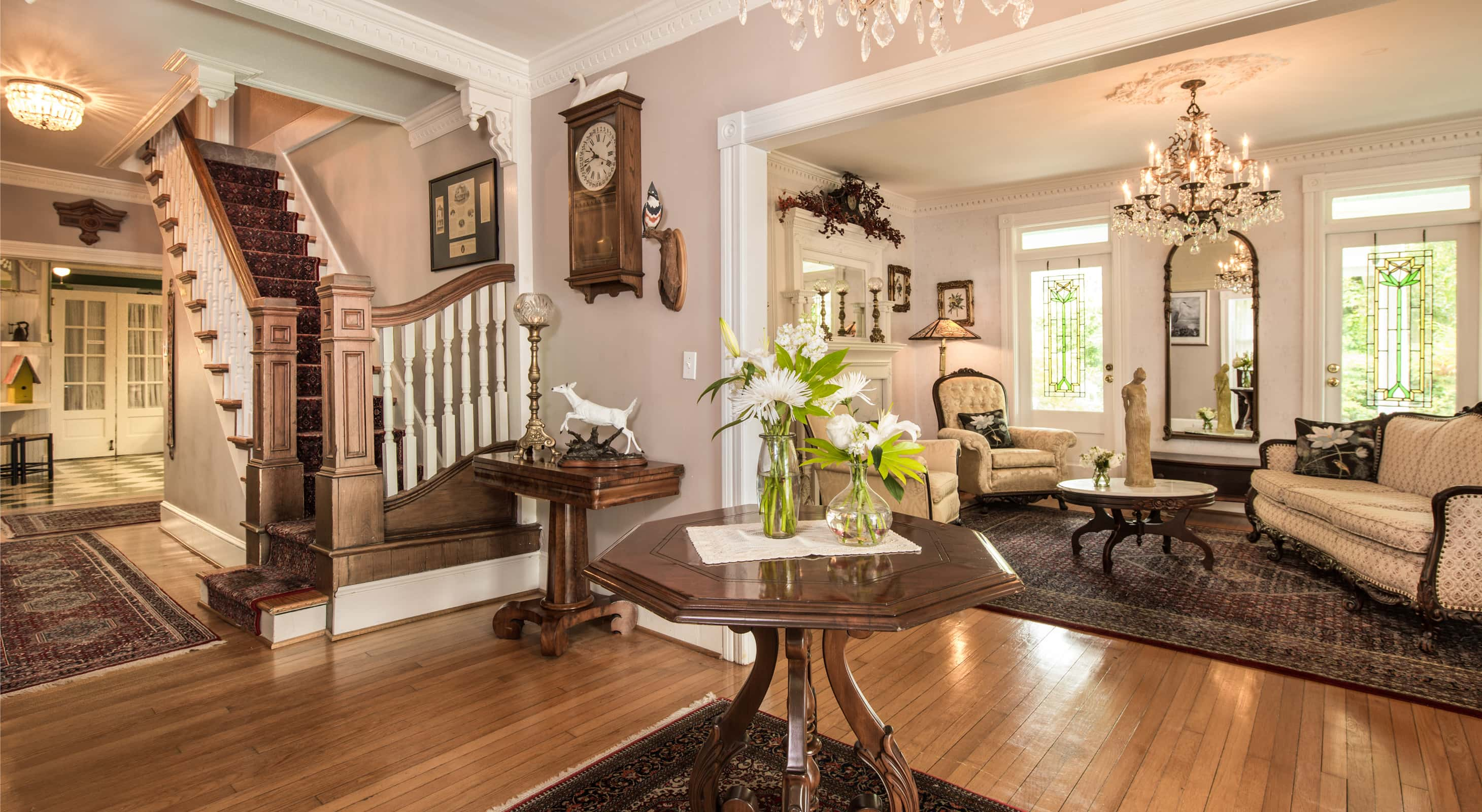 beautiful wood entry, living area and staircase at Outer Banks Area B&B