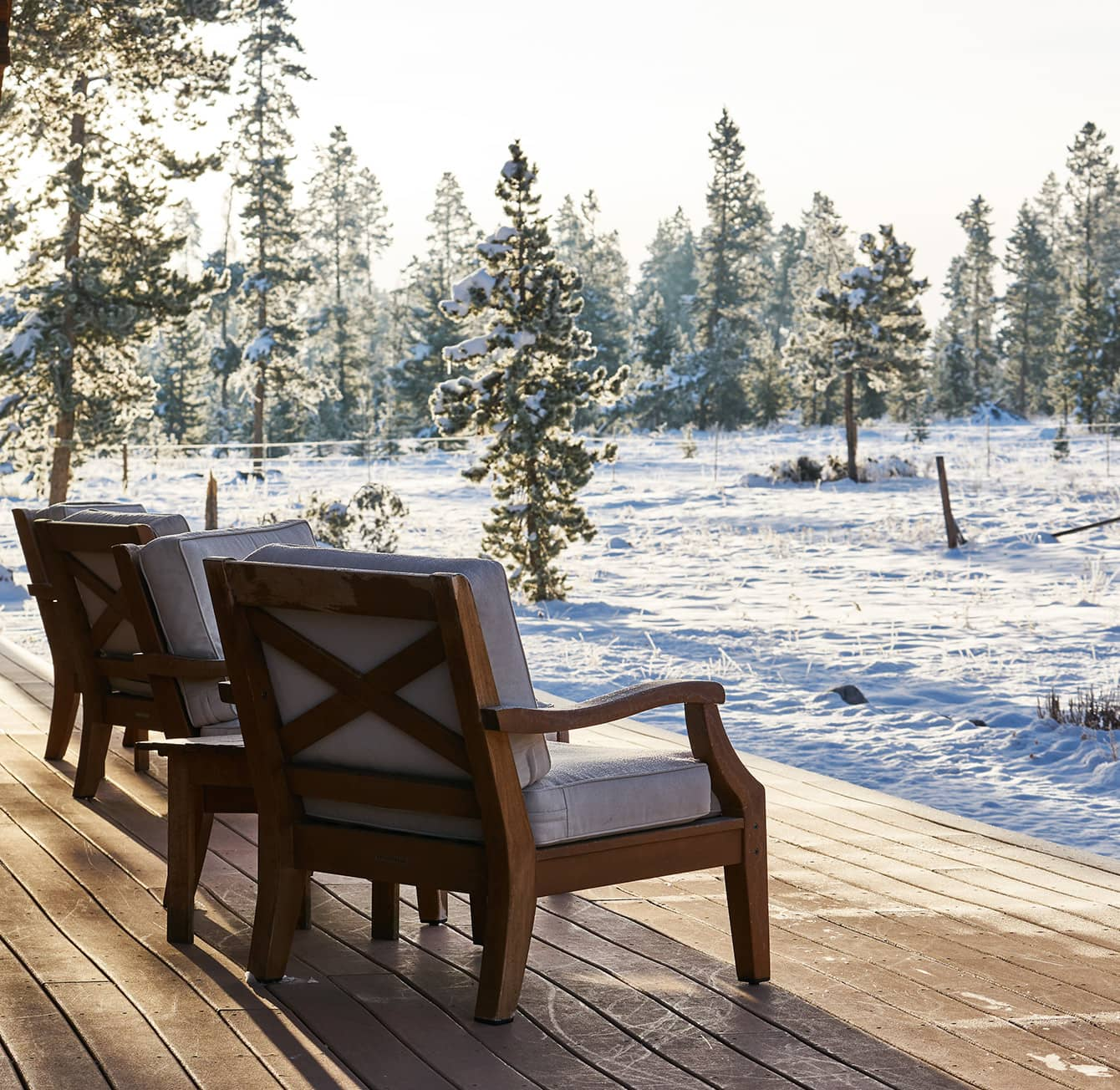 chairs on wooden deck looking at snowy landscape at Wild Horse Inn