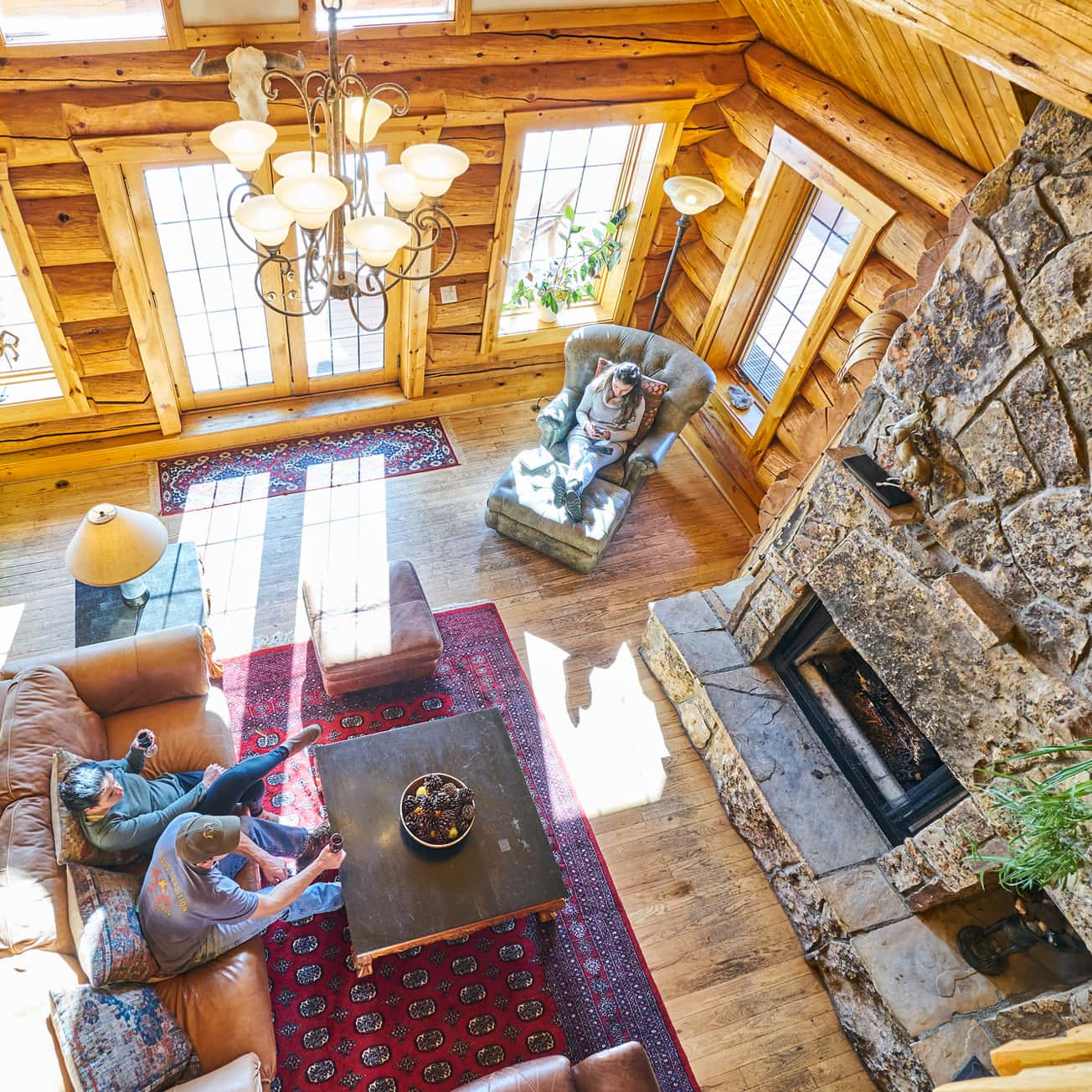 overview interior view of log cabin in Winter Park, Colorado with rock fireplace