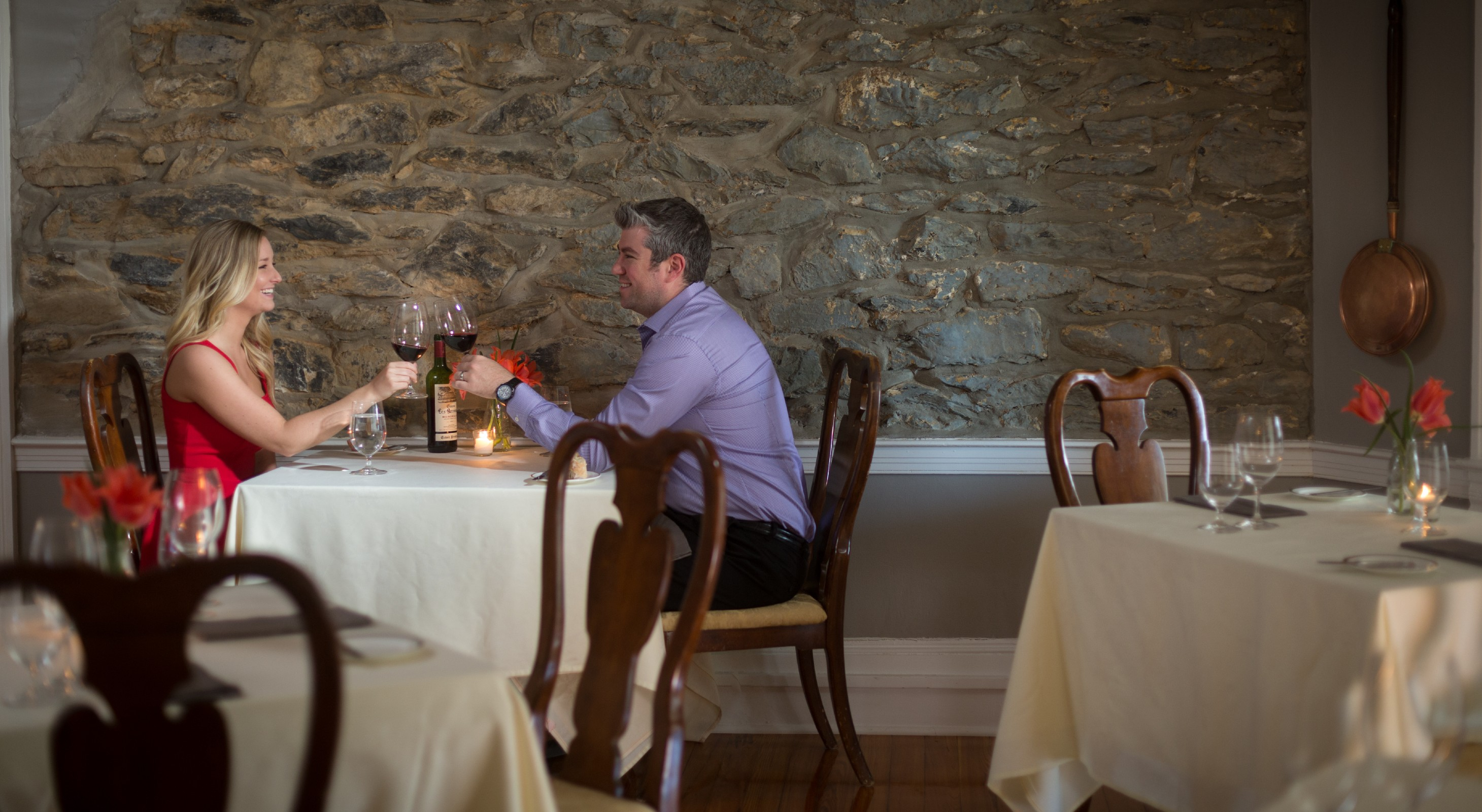 Couple enjoying romantic dinner at L'Auberge Provençale