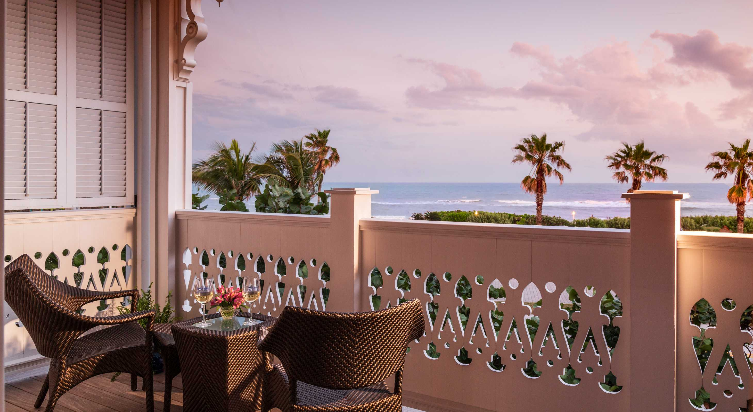 two chairs and wine on ocean view balcony Hotel Marketing Firm