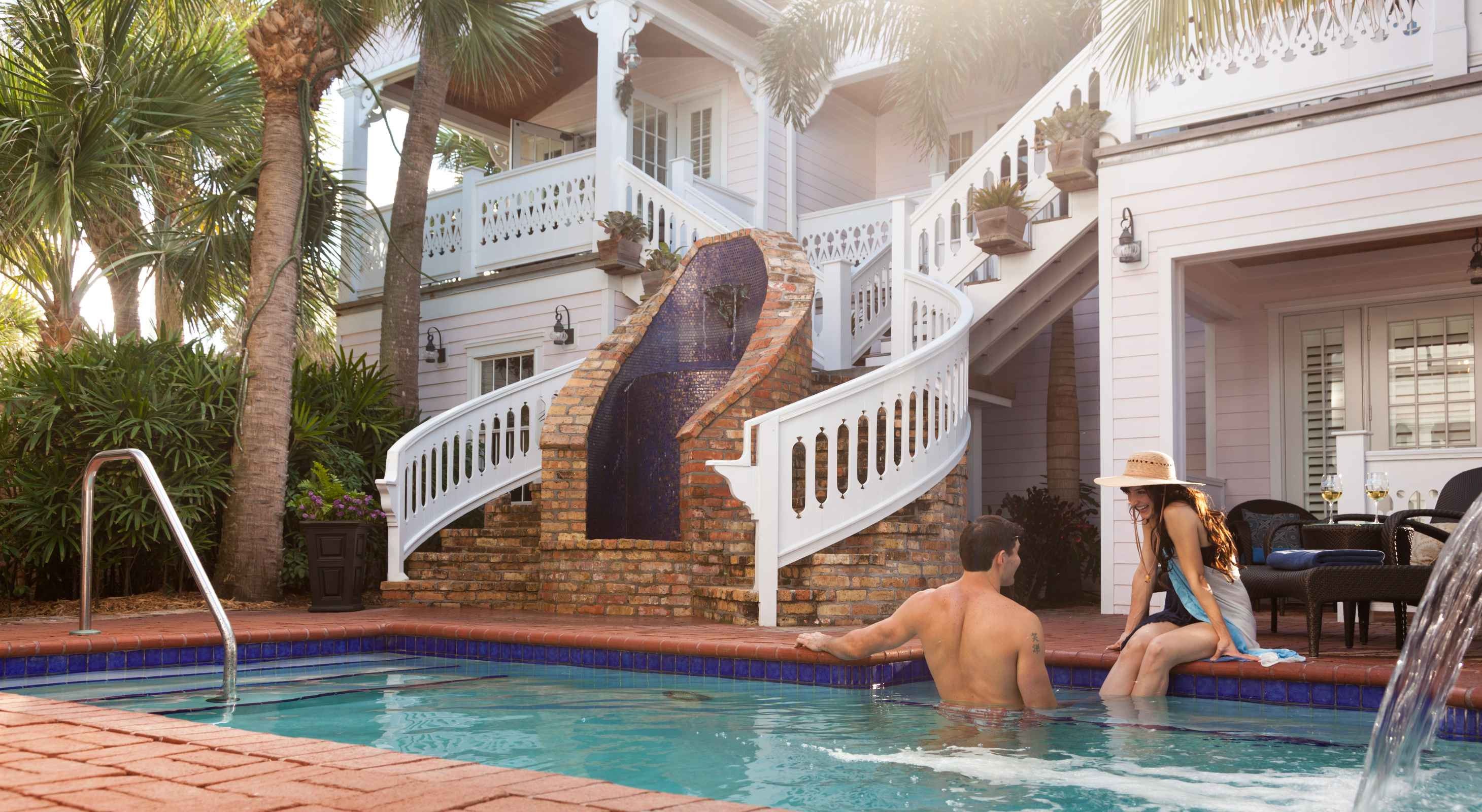 happy man and woman in pool at a Florida Hotel
