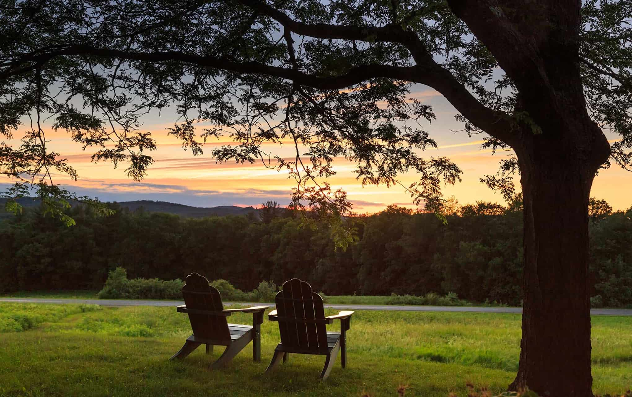two chairs poised to see the sunset in New Hampshire mountains