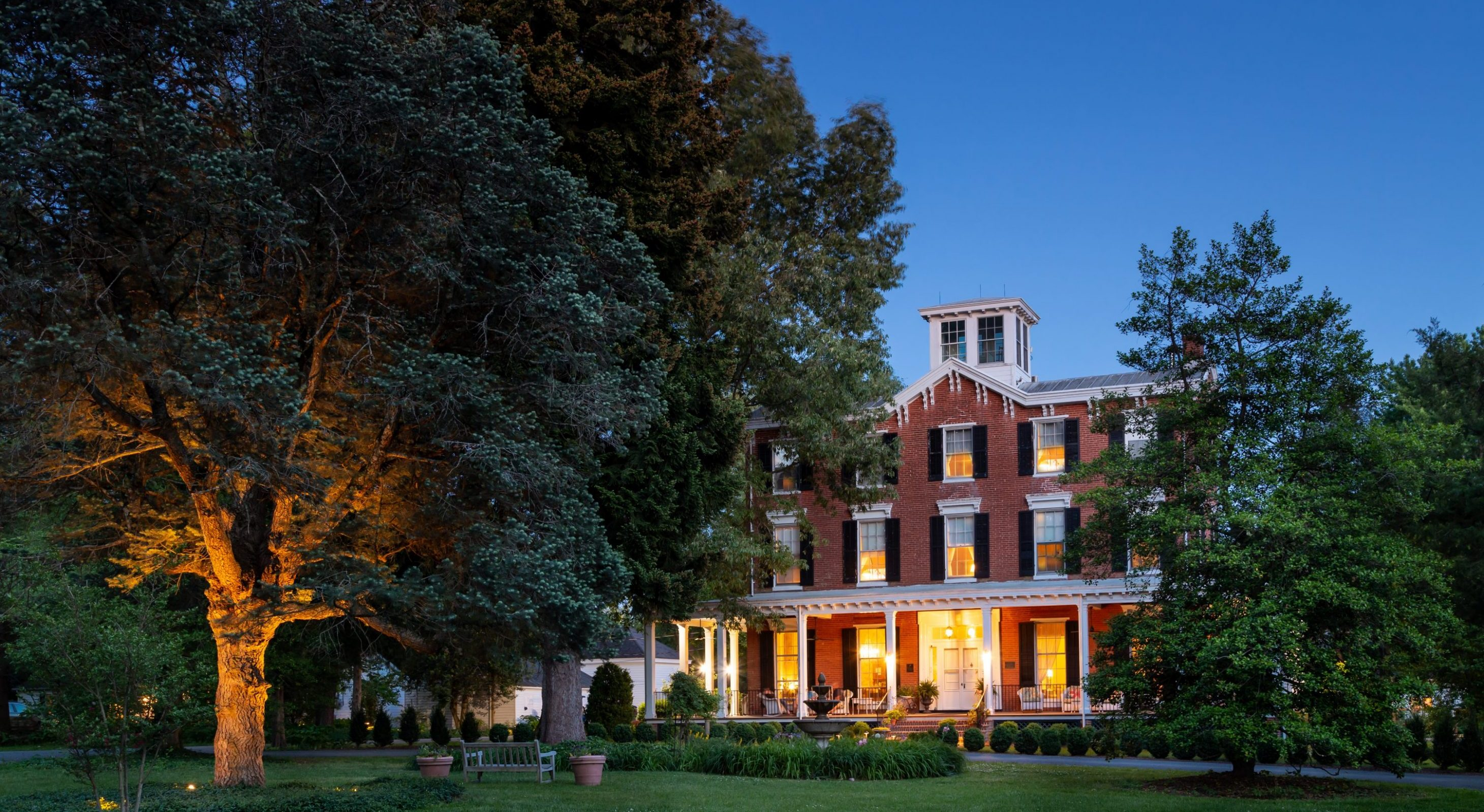 historic brick bed and breakfast at night
