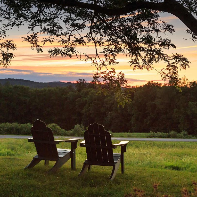 two chairs in NH country setting with sunset