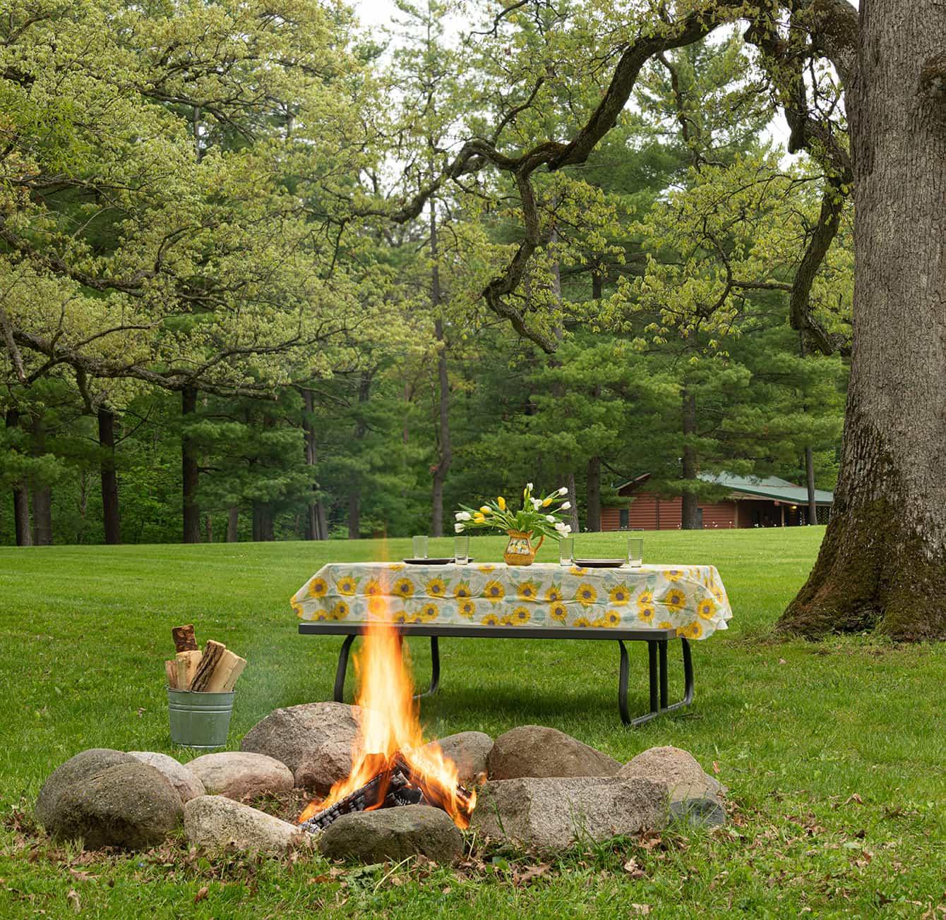 Picnic table and campfire at Kishauwau Cabins