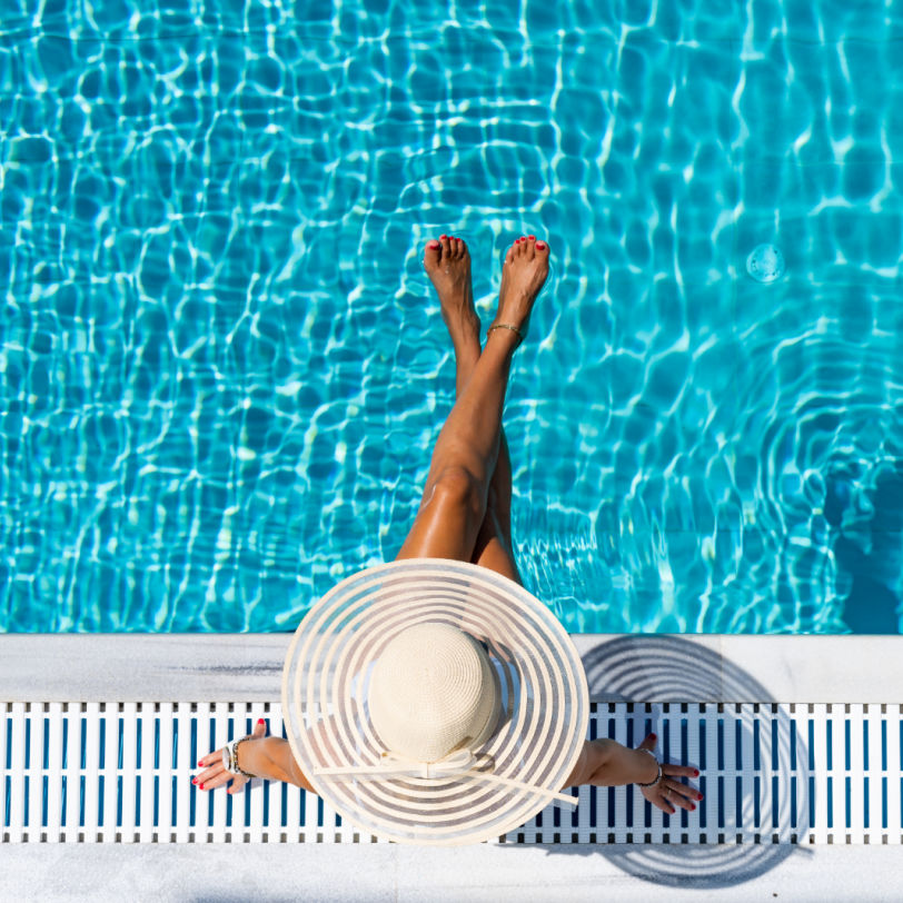 Woman by the pool at a resort